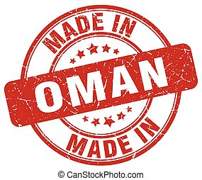 made in Oman red grunge round stamp