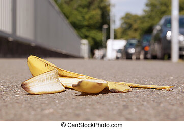 discarded banana skin on pavement - discarded banana skin...