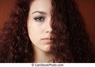 sullen girl with natural curly hair - portrait of sullen...