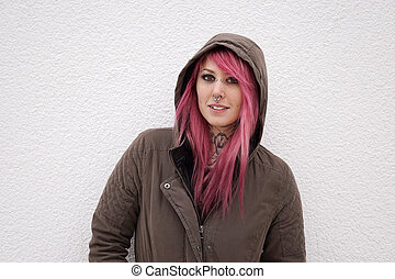 woman with pink hair piercings and tattoos