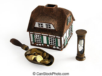 Invest in real estate - House model, coins and hourglass...
