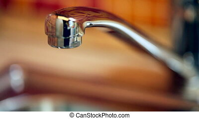 Dripping kitchen faucet - Closeup of water dripping from a...