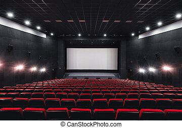 Empty rows of red theater or movie seats. Chairs in cinema hall. Comfortable armchair