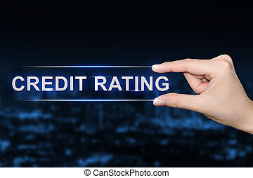 hand clicking credit rating button - hand pushing credit...