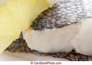 Hake fillet with skin, lemon, macro - Hake fillet with skin...