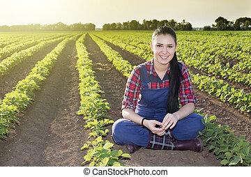 Farmer girl in soybean field - Happy young farmer girl...