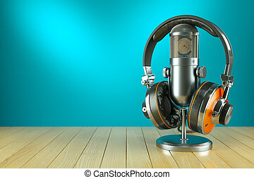 Professional studio microphone and headphones on wooden...