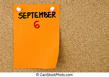 6 SEPTEMBER written on orange paper note