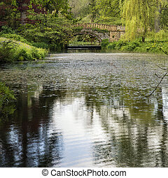 Stunning landscape image of old medieval bridge over river...
