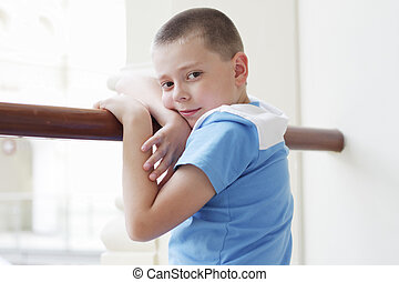 Boy standing at banister closeup
