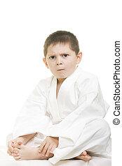 Little displeased karate kid legs crossed - Little...