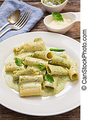 Italian pasta food - rigatoni with pesto sauce and...