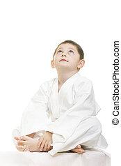 Little karate kid legs crossed looking up - Little karate...