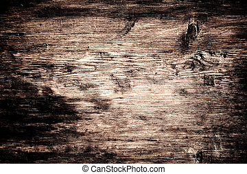 weathered barn wood background with knots and nail holes /...