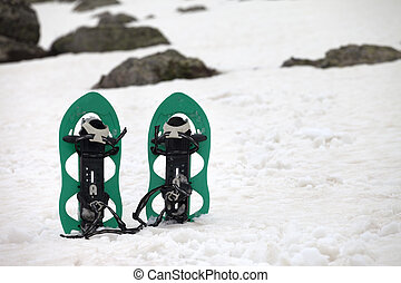 Snowshoes in snowy mountains. Close-up view.