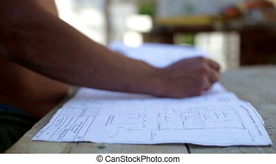 Work studying drawing at a construction site