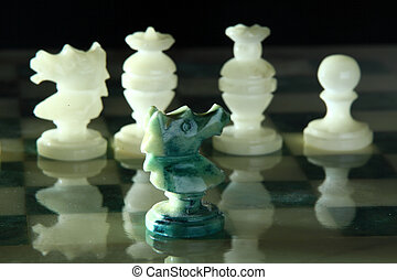 close up alabaster chess x - alabaster chess on a black...