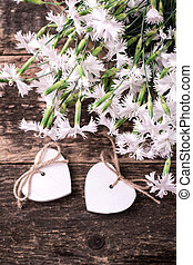 white spring flowers on wooden background.