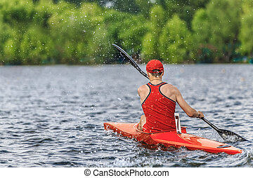athlete canoeists during rowing competitions - man athlete...