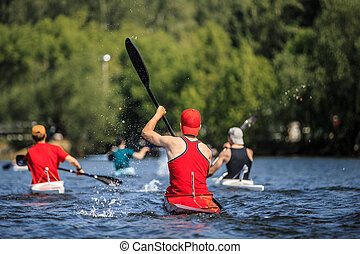 group of athletes canoeists boating on lake in a kayak....