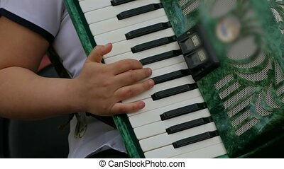 boy leaves the accordion in his hands slow motion video -...