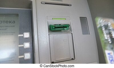 man inserts a card into the ATM video slow motion - close up...