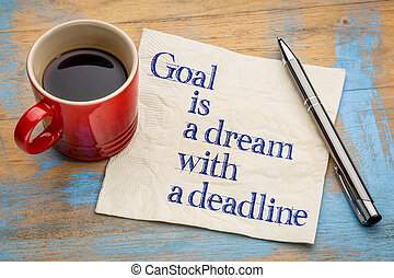 goal is a dream with deadline - handwriting on a napkin with...