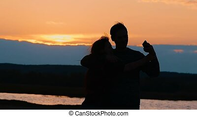 silhouettes of man and woman photographed selfie slow motion...