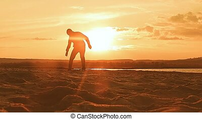sunset man playing soccer ball, slow motion video - sunset...