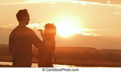 couple in love dancing at sunset slow motion video - evening...