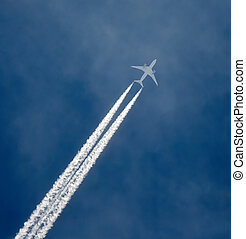Jet airplane in flight - Jet airplane in the sky, leaving...
