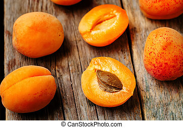 apricots on a dark wooden background. toning. selective...