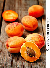 apricots on a dark wooden background toning selective focus...