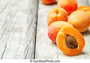 apricots on a white wooden background toning selective focus...