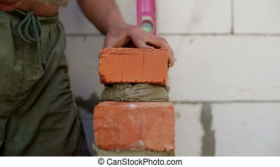 Work lays bricks on a construction site