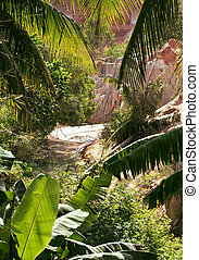 green landscape with palms and white sand rocks, fairy...