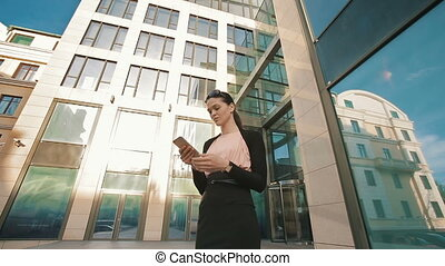 Business woman using cell phone - confident businesswoman...