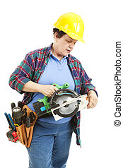 Confused by Power Tools - Female contruction worker trying...