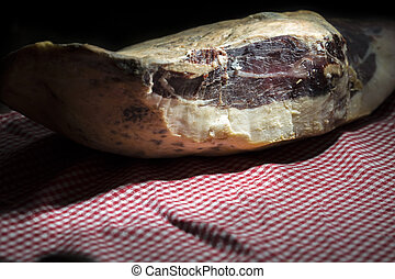 Pata Negra Ham - A pata negra spanish dried ham on a dark...