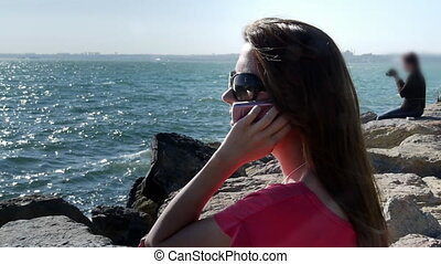 Girl phone talking coast sea smile