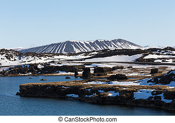 Myvatn volcano with small lake and clear blue sky...
