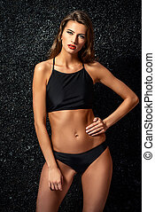 black swimsuit - Attractive young woman in black bikini and...