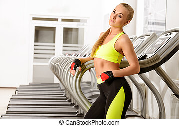 work out on treadmill - Beautiful athletic young woman...