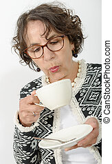 beautiful mature woman drinking tea - a beautiful mature...