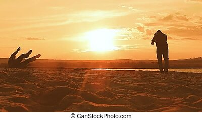 man falls with the ball at sunset slow motion video - falls...