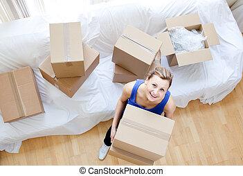 Beautiful woman holding a box