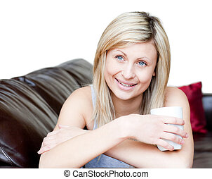 Confident woman holding a cup of coffee