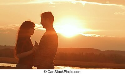 evening loving couple embracing at sunset slow motion video