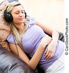 Sleeping woman using headphones on a sofa