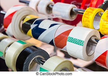 Rolls of packing tapes - Rolls of different packing tapes in...